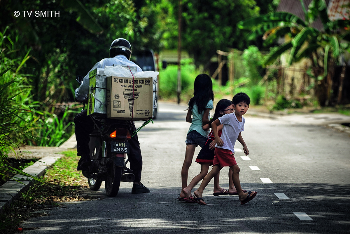 Slow Down: Kids Crossing