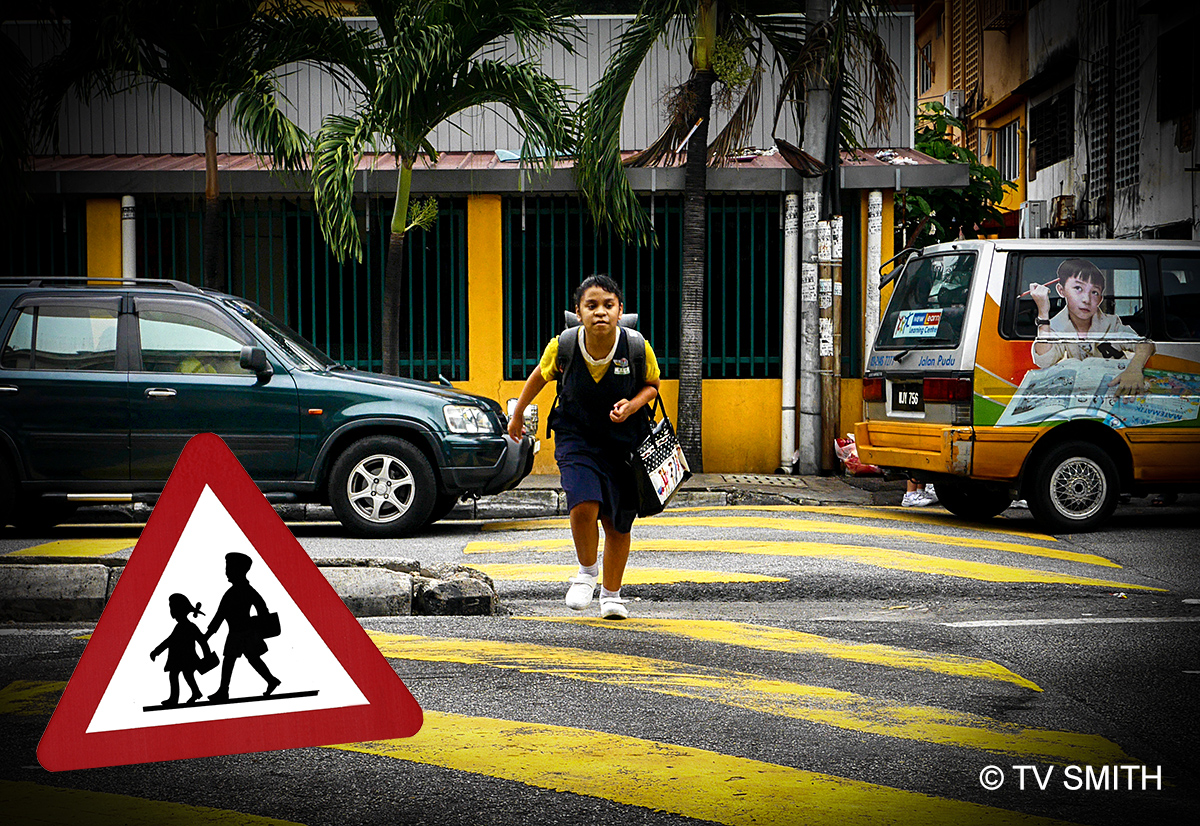 Caution: School Kids With Heavy Bags Crossing